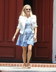 Reese Witherspoon was spotted outside her office looking laid-back yet stylish in a white denim jacket layered over a blue print dress.