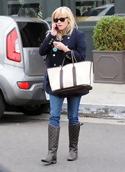 Reese Witherspoon went out for lunch in Brentwood, CA wearing a pair of quilted brown leather boots.