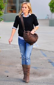 Reese carries this practical leather messenger bag for a meeting in Santa Monica.