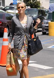 Reese Witherspoon showed off her casual side in a floral Madwell dress and quilted leather bag.