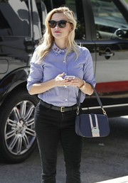 Reese Witherspoon blocked the rays with chic Stella McCartney wayfarers.