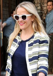 Reese Witherspoon looked beach-ready when she wore these white-rimmed Saint Laurent sunnies while out in New York City.