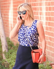 Reese Witherspoon headed out in LA wearing a modern version of the classic cateye sunglasses.
