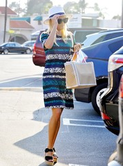 Reese Witherspoon stepped out for some shopping wearing a striped foliage-print dress by Draper James.