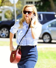 Reese Witherspoon accessorized with a chic red Chloe Drew bag while shopping in Brentwood.