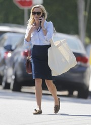 Reese Witherspoon went shopping in Brentwood wearing a denim pencil skirt and an embroidered button-down, both by Draper James.