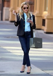 Reese Witherspoon was business-chic in a black blazer layered over a blue checkered shirt while shopping in New York City.