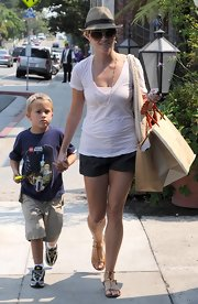 On another day out with her son Deacon, Reese wore a cute summer outfit and topped it off with a dashing fedora hat.