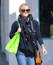 Reese Witherspoon stepped out in Hollywood wearing this navy scarf with white geometric designs.