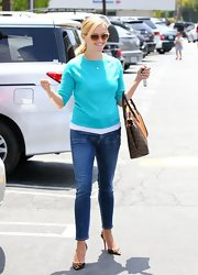 Reese's skinny jeans showed off her adorable leopard-print heels.