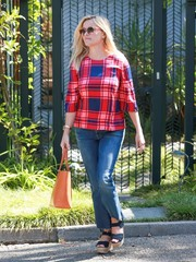 Reese Witherspoon was spotted out in Santa Monica looking vibrant in a red, blue, and pink plaid blouse.