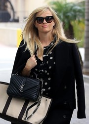 Reese Witherspoon showed off a chic black Saint Laurent quilted bag and a two-tone Hermes tote while out in Beverly Hills.