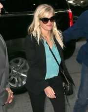 Reese Witherspoon looked chic wearing these butterfly sunnies while out in New York City.