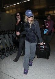 Renee Zellweger touched down at LAX looking cozy in a blue and gray puffer jacket.