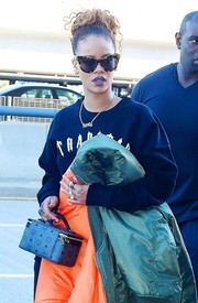 Rihanna wore over-sized tortoise shell cat-eye sunglasses while departing on a flight at JFK Airport in New York City on September 14, 2015.