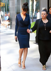 Rihanna looked serenely elegant in this navy blue long sleeve dress.