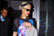 Singer Rihanna seen leaving her hotel and heading to the airport in New York City, NY on March 18, 2012.