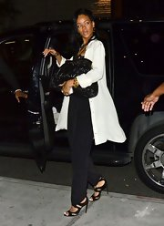 Rihanna carried her oversize black clasp bag out with her for Mother's Day.