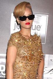 Riri completed her dangerously spiky look with a pair of silver safety pin earrings. Ouch!
