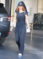 This is how Rihanna dresses to go shopping. That ruched black gown looks elegant enough for any red carpet event.