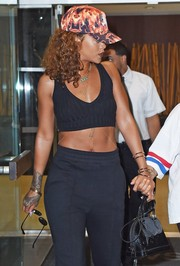 Rihanna styled her sporty outfit with a black Louis Vuitton Mini Alma BB bag for a day out in New York City.