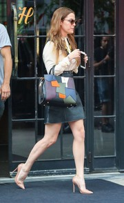 Riley Keough's black leather mini (also by Coach) did a good job of showing off her toned legs.