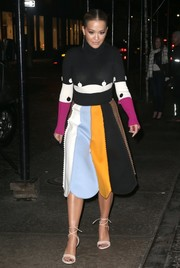 Rita Ora amped up the charm with a scalloped color-block skirt, also by Ferragamo.