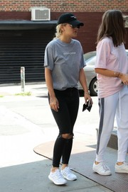 Rita Ora chose a loose gray tee for her off-duty look.