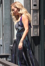 Rita Ora paired interlocking bangles with a sequin dress for a day out in New York City.
