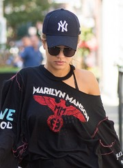 Rita Ora looked a little shy with her New York Yankees cap and dark glasses while out and about.