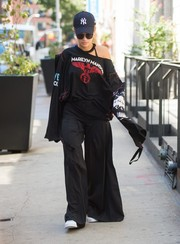 Rita Ora complemented her slouchy top with a pair of wide-leg pants.