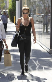 Comfy black sneakers completed Rita Ora's laid-back look.