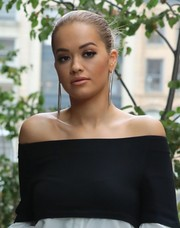 Rita Ora headed out in New York City wearing her hair in a classic and elegant bun.