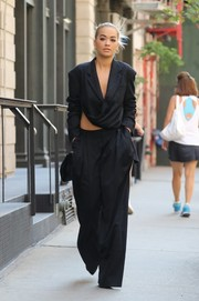 Rita Ora completed her baggy outfit with black wide-leg pants.
