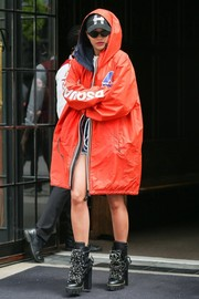 Rita Ora tried to go incognito in an orange raincoat with the hood up while out in New York City.