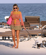 After a spot of sun-baking, Rita Rusic departed the beach in a pretty print cover-up.