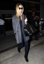 Rosie Huntington-Whiteley kept warm with a classic gray pea coat by Isabel Marant for H&M as she arrived at LAX.