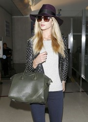Rosie Huntington-Whiteley finished off her look with a cute purple walker hat by Eugenia Kim.