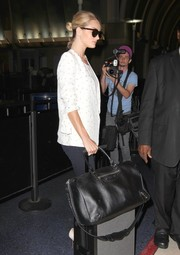 Rosie Huntington Whiteley was spotted at LAX lugging a stylish black Balenciaga duffle.