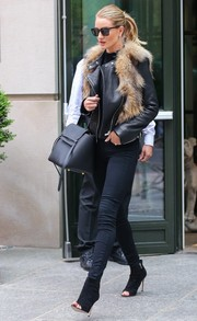 Rosie Huntington-Whiteley completed her fierce outfit with black suede peep-toe booties by Gianvito Rossi.
