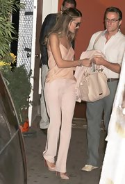 Rosie Huntington-Whiteley was stylish in her monochromatic slacks and cami ensemble by The Row.