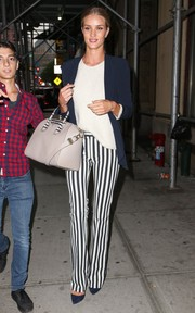 Rosie Huntington-Whiteley flawlessly styled her blazer/sweater combo with a pair of black-and-white striped pants.