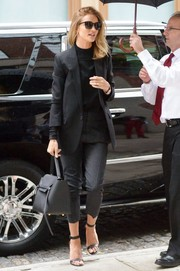 Rosie Huntington-Whiteley styled her look with a black Celine leather tote.