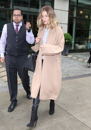 Rosie Huntington-Whiteley bundled up in a long beige cardigan by Babaton for Aritzia for a day out in New York City.
