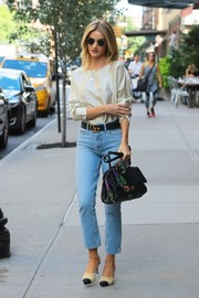 Rosie Huntington-Whiteley dressed down her elegant top with a pair of jeans.