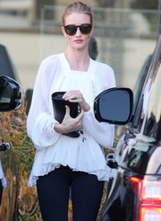 Rosie Huntington-Whiteley stepped out for some errands carrying a black croc-embossed leather clutch by Saint Laurent.