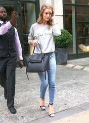 Rosie Huntington-Whiteley was casual and cute in a gray Saint Laurent 'Too Late' sweater and skinny jeans while out in New York City.