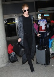 Rosie Huntington-Whiteley was rocker-glam in a Balmain printed coat layered over a black top and jeans as she arrived on a flight at LAX.