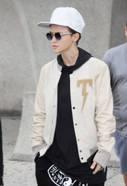 Ruby Rose wore a white baseball cap while arriving on a flight in Washington DC.