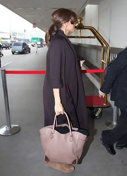 Eva Mendes sported a low maintenance and casual messy ponytail before boarding a plane at LAX airport in Los Angeles.